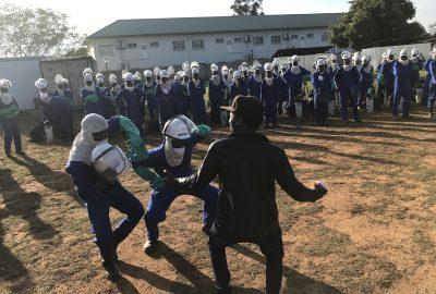 A-local-musician-dances-to-energize-the-spray-operators