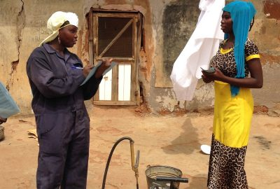 Female spray operator collecting household information