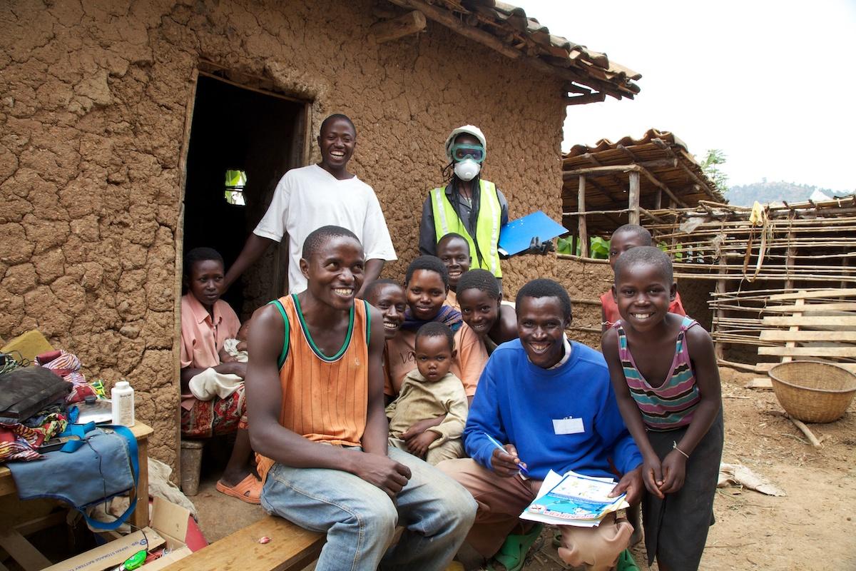 IRS spray campaign team with villagers, Rwanda