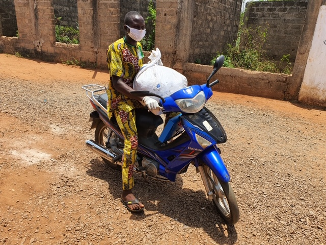 Delivering nets household to household in advance of the rainy season in Benin