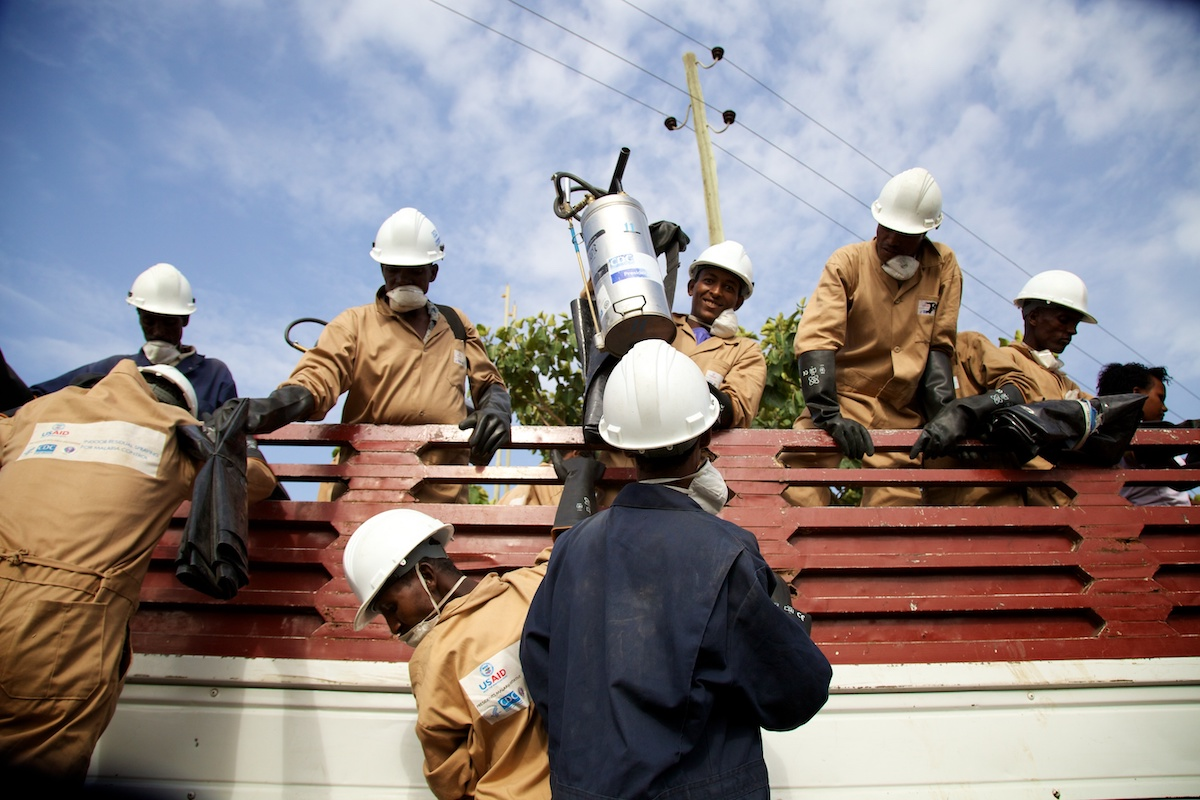 IRS spray team unload their truck during IRS campaign, Ethiopia 2014