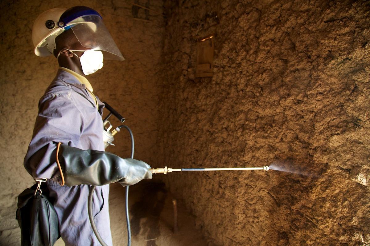 IRS spray operator conducting internal house spraying, IRS campaign, Rwanda, 2014