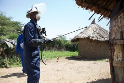 IRS spray operator carrying out house spraying during IRS spray campaign, Ethiopia, 2014