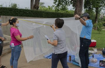Staff of Inspection Committee from the Department of Disease Control (DDC), Ministry of Public Health (MOPH), Thailand measuring the Long-Lasting Insecticidal Net (LLIN) to make an assessment of the quality standard. USAID/PMI and Global Fund provided LLINs to the Royal Thai Government in an effort to eliminate malaria.